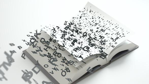 Aufgeschlagenes Buch aus dem Buchstaben strömen © Mopic, Fotolia