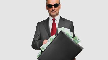 Mann mit Sonnenbrille und Geldkoffer © Coloures-pic, Fotolia.com